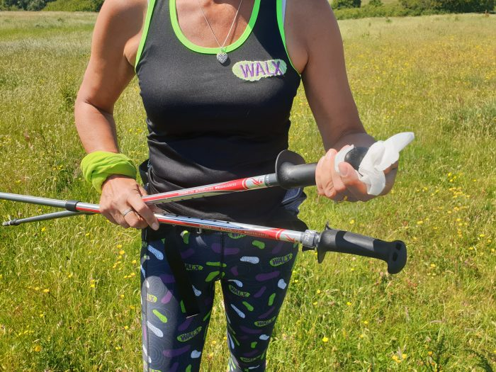 WALX Instructor cleans her Nordic Walking poles