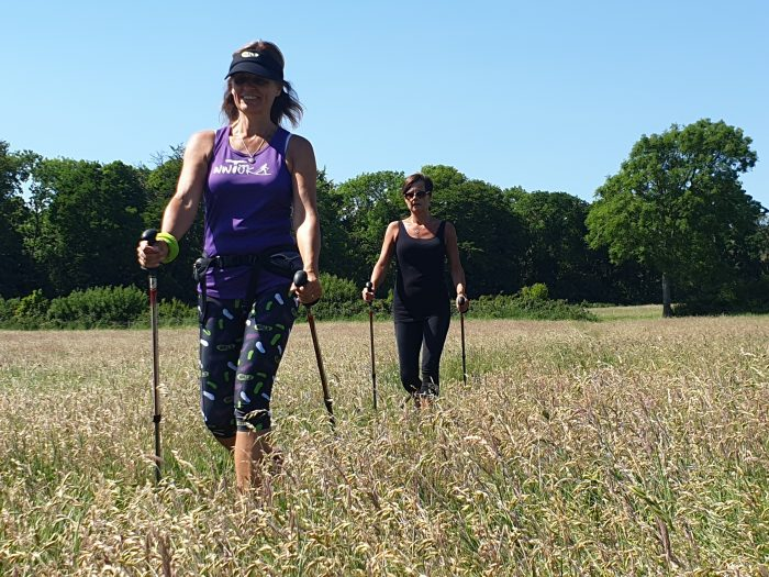 Two Ladies Nordic Walking with moulded handled poles - the power of poles